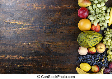 bright fruit on wooden background