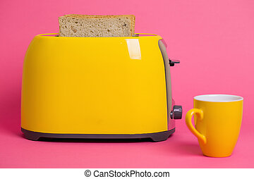 yellow toaster on a pink background