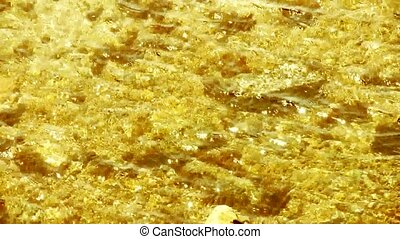 Bright gold clear & transparent Repulse Bay ripple,Sparkling...