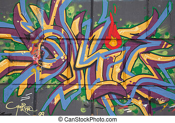 Bright graffiti on concrete wall. Abstract drawing. Street graphics.