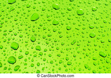 Bright Green Car Body Paint Covered by Car Wash Water Drops Background