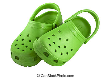 bright green plastic beach clogs isolated on white with clipping paths