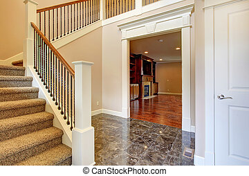Bright hallway with staircase
