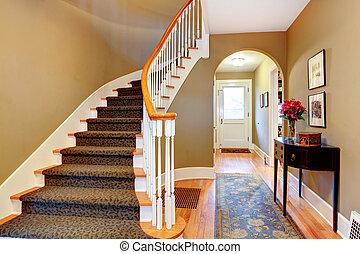 Bright hallway with wood stairs and archway - Warm colors...