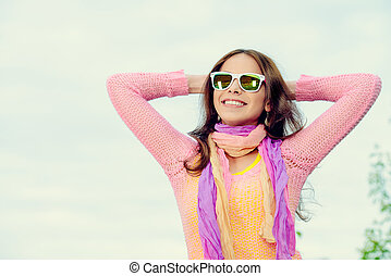 bright happiness - Beautiful smiling girl in bright clothes...