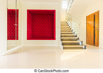 Bright house corridor with modern stairs