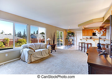 Bright house interior. Living room with kitchen area