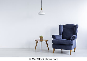 Bright interior with blue armchair