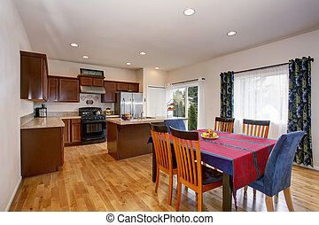Bright kitchen and dining room interior with colorful...
