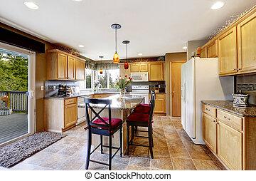 Bright kitchen room interior with walkout deck