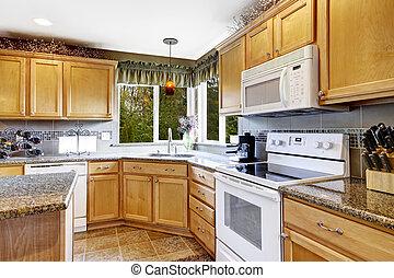 Bright kitchen room interior with white appliances