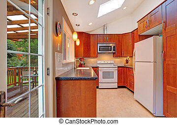 Bright kitchen room with skylight and walkout deck