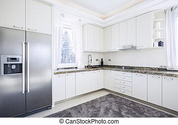 Big bright kitchen with modern equipment