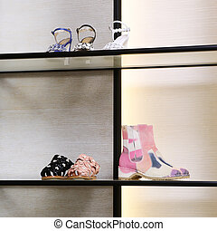 Bright large luxury shoe store with new collection.
