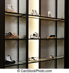 Bright large luxury shoe store with new collection