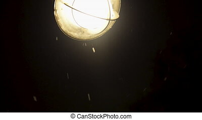 Bright Light and Snow Falling - A bright light and falling...