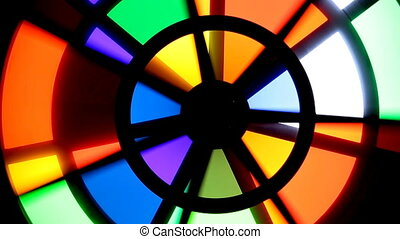 Bright light colored spinning wheel. Futuristic background