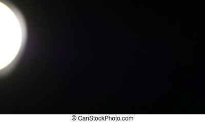 Bright Light of Flashlight - Lantern on a black background...