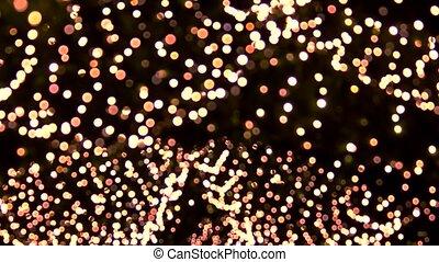 Bright lights moving. Suspended blured lights.