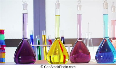 bright liquids in flasks to microsc - The camera dollies...