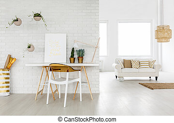 Bright loft apartment with working area and sofa