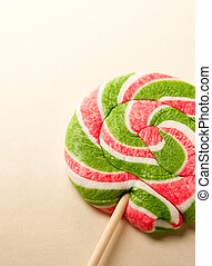 Bright lollipop candy on paper background