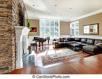 Bright luxury living room with stone fireplace and cherry hardwood.