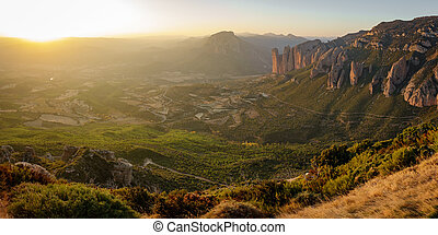 Bright Mallos of Riglos at sunset from top of the mountain