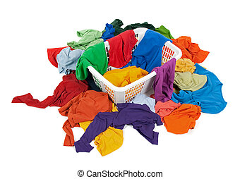Bright messy clothes in a laundry basket and around it. ...
