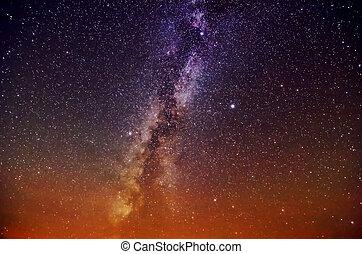 Bright Milky Way on reddish violet sky
