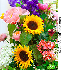 Bright multicolor bouquet made of different flowers