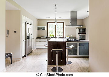 Bright open kitchen with refrigerator
