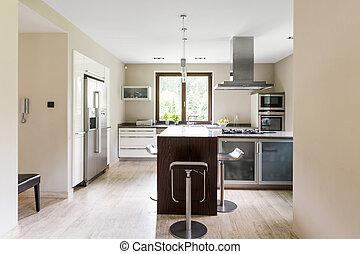 Bright open kitchen with refrigerator