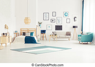 Bright open space interior - Blue carpet and armchair in...