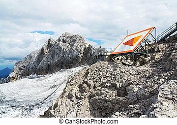 Bright orange arrow near cable car station on Dachstein glacier