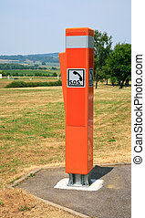 orange light reflecting traffic box SOS