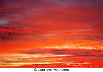 Bright orange, red and yellow colors sunset sky. Apocalyptic sunset sky Background