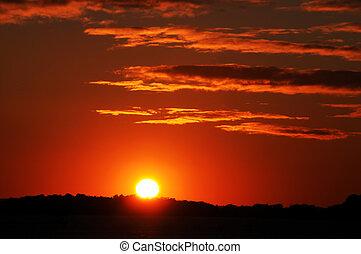 bright orange, red and yellow sunset
