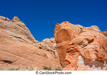 Bright Orange Sandstone and Deep Blue Sky