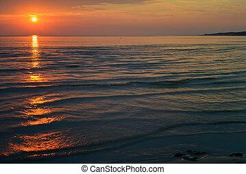 Bright orange sunset at the sea