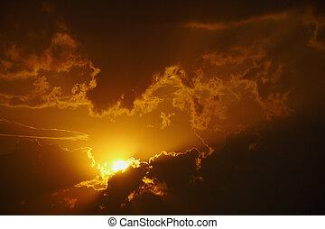 Bright orange sunset in clouds