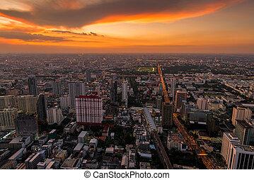 bright orange sunset over the city of Bangkok, Thailand