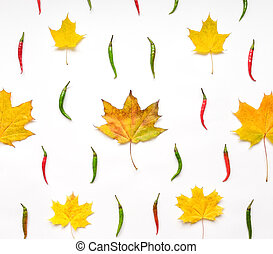 Bright pattern with autumn leaves and peppers on white background. Flat lay, view from above
