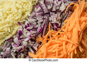 Bright photo food. Vegetables: carrots, onions, turnip. Grated vegetable close up in the kitchen. Food concept.