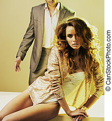Bright photo of serious woman and man behind