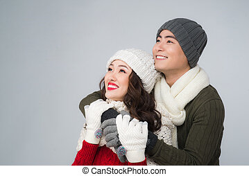 Bright picture of asian family couple in a winter clothes
