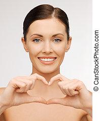 woman showing heart shape