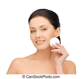beautiful woman with cotton pad