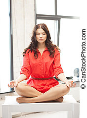 calm attractive woman in lotus pose