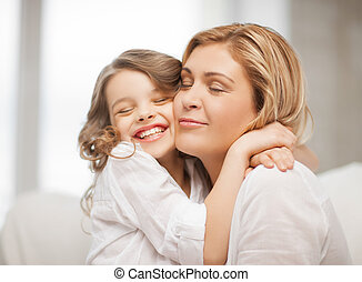 mother and daughter - bright picture of hugging mother and ...